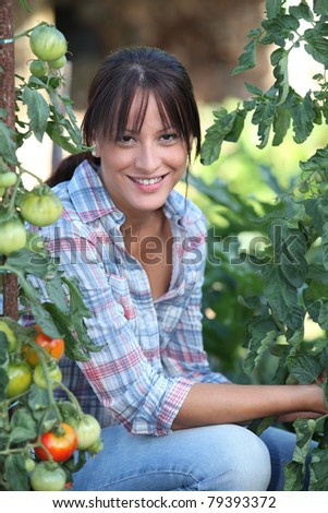 Girl next to tomatoes - stock photo