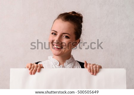 girl of the European appearance in business style on a neutral background