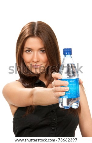 Girl offer and give bottle of pure still drinking water for diet. Female holding in hand sparkling mineral bottled water isolated on a white background - stock photo