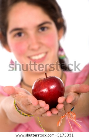 girl offering an apple while smiling over a white backgroudn