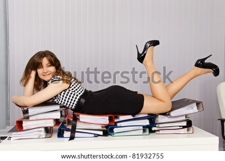 Girl - office worker lay down comfortably on the documents - stock photo