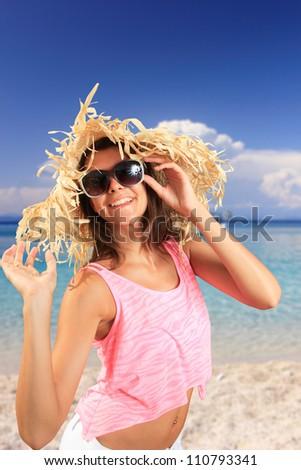 Girl on a beach in greece - stock photo