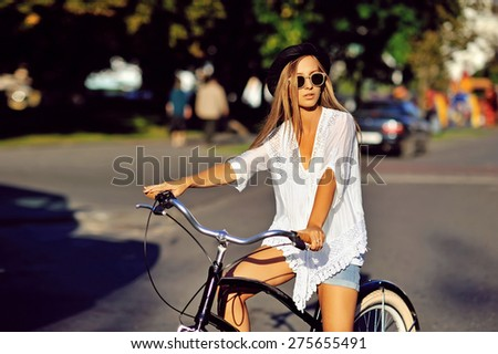 Girl on a bicycle  - stock photo