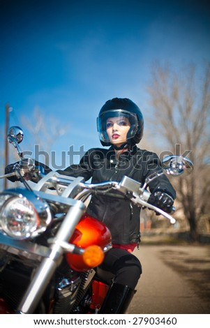 girl on a motorcycle - stock photo