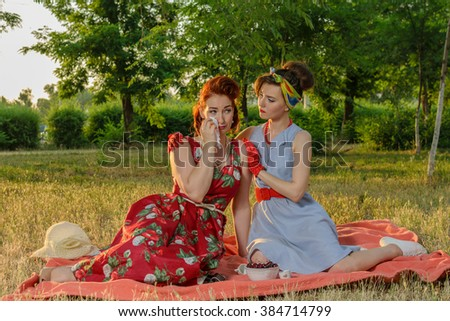 Girl on a picnic and sit gossiping. retro style - stock photo