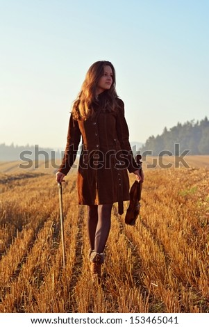 Girl on a walk with Violin - stock photo