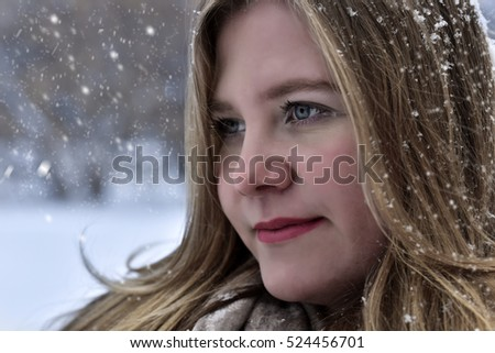 Girl  on a winter walk in a city park