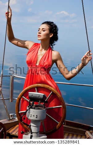 Girl on a yacht in the summer - stock photo