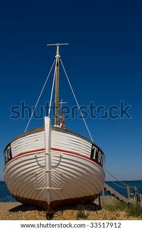 Girl on an old fishingboat - stock photo