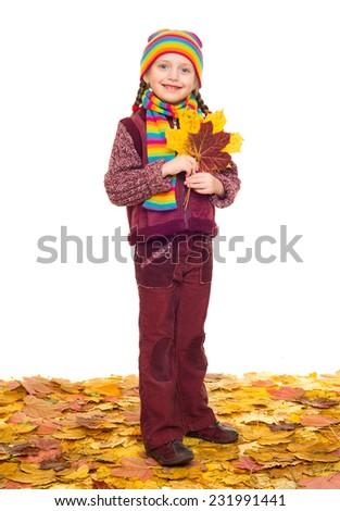 girl on autumn leaves studio shoot on white - stock photo