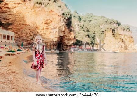 girl on beach at sunset - stock photo