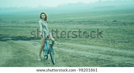 girl on bike. picture in the soft light of the - stock photo