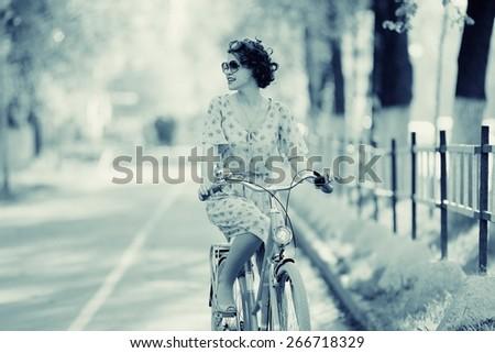 girl on bike sunset summer sun - stock photo