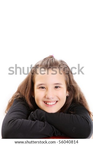 Girl on black smiling and looking the camera. Space to insert text or design - stock photo