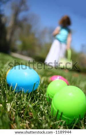 Girl on easter egg hunt - stock photo