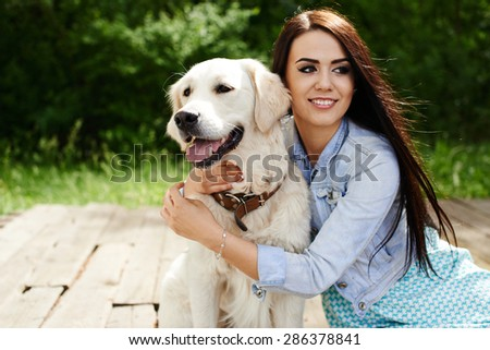 Girl on nature with a dog