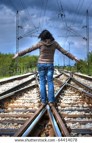 girl on railroad (HDR image) - stock photo
