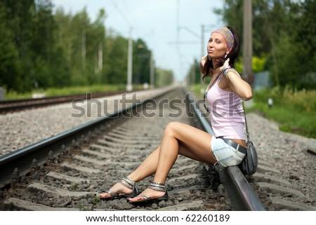 Girl on rails - stock photo