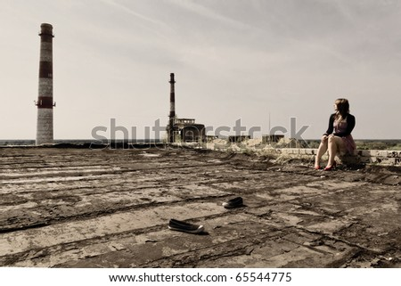 girl on roof in the lone industrial  town - stock photo