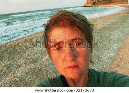Girl on sea coast - stock photo