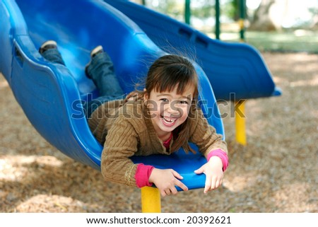 Girl on Slide at a Park