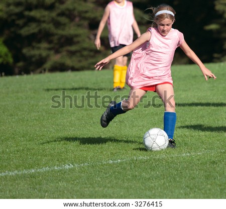Girl on Soccer Field 21 - stock photo