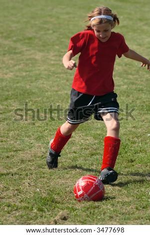 Girl on Soccer Field 34 - stock photo
