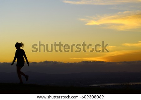 Girl on sunset silhouette
