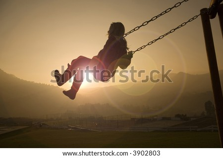 Girl on Swing in a country club at sunset