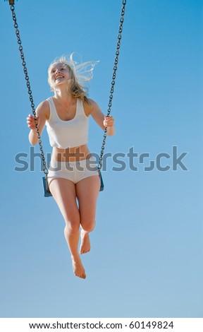 Girl on Swings - stock photo