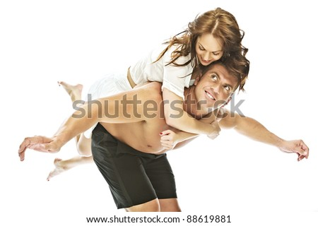 girl on the back of a man having fun in love and romantic - stock photo