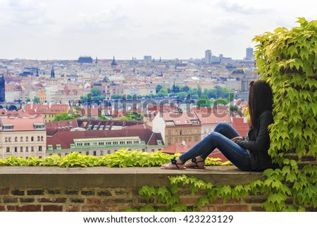 Girl on the background of the panorama of Prague, Czech Republic - stock photo