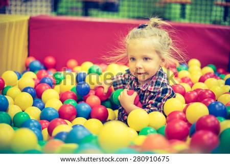 Girl on the balls - stock photo
