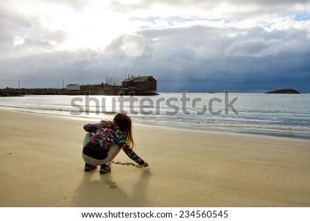 girl on the beach. Senja  - stock photo