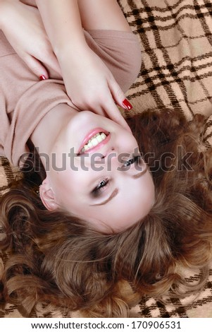 girl on the beige plaid - stock photo