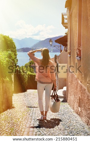 Girl on the cobbled street of Menaggio town. Lake Como, Italy - stock photo
