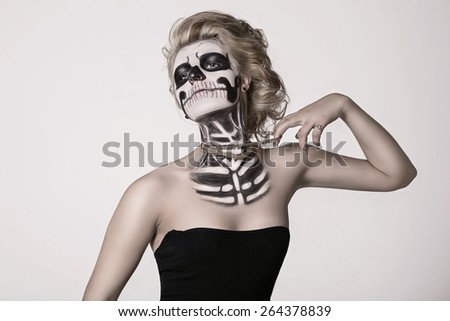 girl on the face of the skeleton - stock photo