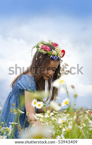 Girl on the field with daisies and poppy - stock photo