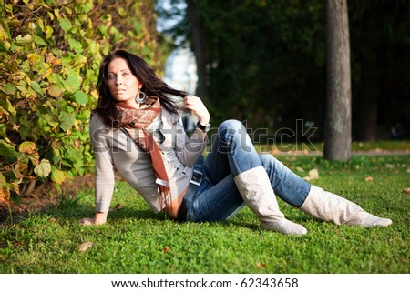 Girl on the grass - stock photo