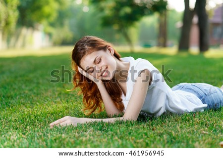 girl on the grass in a shirt and shorts