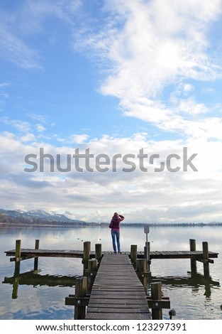 Girl on the jetty - stock photo