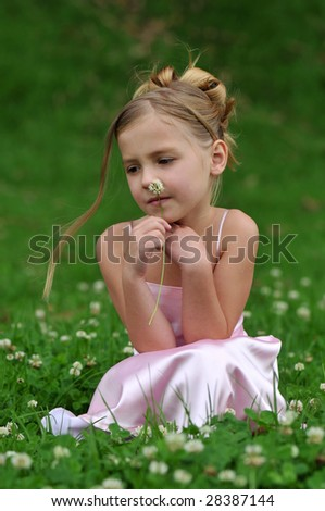 Girl on the lawn - stock photo