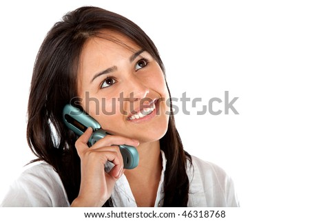 Girl on the phone looking happy isolated on white