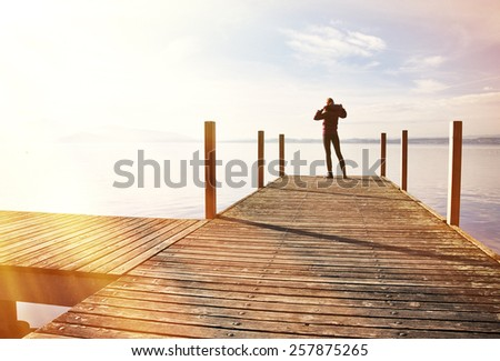 Girl on the pier. Lake of Zug, Switzerland - stock photo