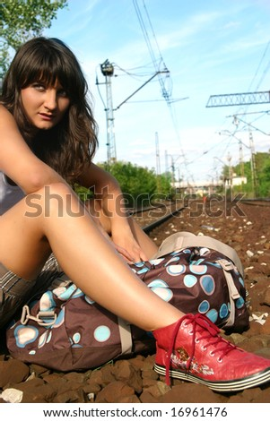 girl on the rail track waiting for train