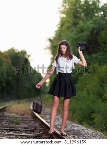 Girl on the railway line - stock photo