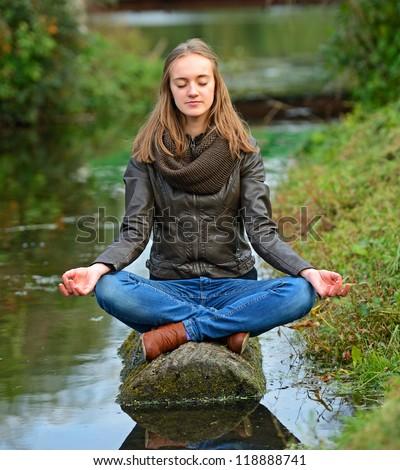 Girl on the riverside - stock photo