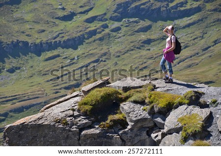 Girl on the rock - stock photo