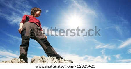 Girl on the rocky cliff