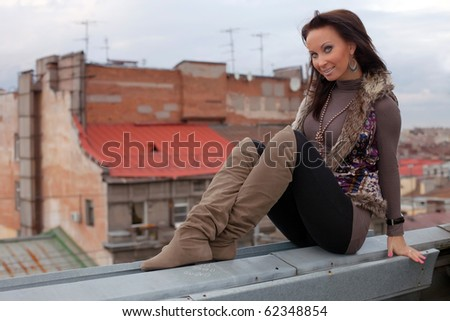 Girl on the roof - stock photo